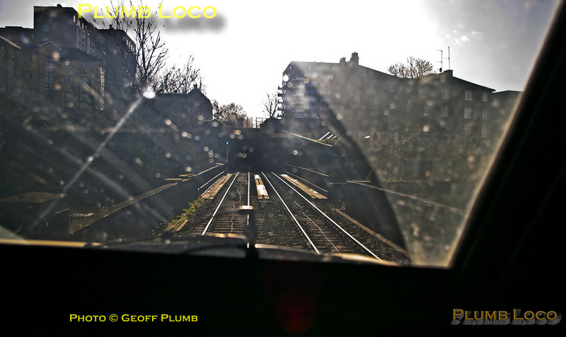 As 82304 emerges from Hampstead Tunnel it is about to cross over the WCML out of Euston before plunging into St. John's Wood Tunnel, giving very little time to get the exposure and framing of the shot right, especially heading straight into the sun! Test train 5H32, 12:46, Sunday 27th January 2013. Digital Image No. GMPI13956.