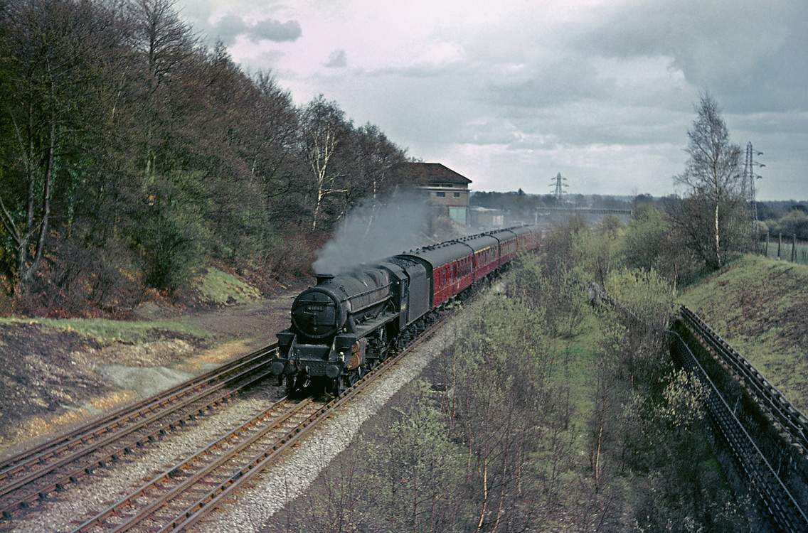 """LMS """"Black 5"""" 4-6-0 No. 44848 is in charge of the 14:38 semi-fast from London Marylebone to Nottingham Victoria and has just shut off as it approaches Rickmansworth at Watford South Junction, Tuesday 13th April 1965. Slide No. 1281."""
