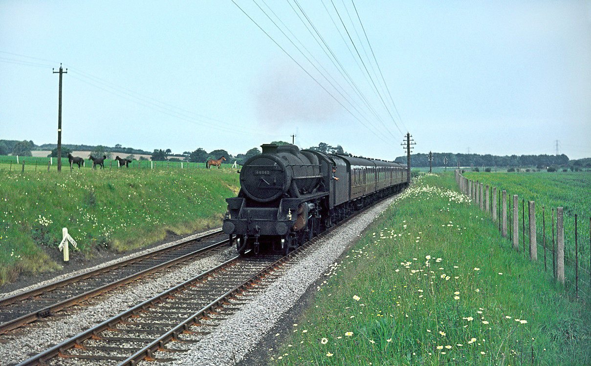 """""""Black 5"""" 4-6-0 No. 44843 is just passing the gradient post that marks the summit of the climb through the Chiltern Hills at Dutchlands, between Wendover and Great Missenden. It is working the 08:15 semi-fast train from Nottingham Victoria to Marylebone on Thursday 10th June 1965. Slide No. 1345."""