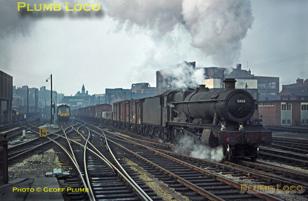 "GWR ""Hall"" class 4-6-0 No. 5988 ""Bostock Hall"" pounds up the gradient into Birmingham Snow Hill station with a long fitted freight from the Wolverhampton direction on the afternoon of Saturday 21st November 1964. Slide No. 1110."