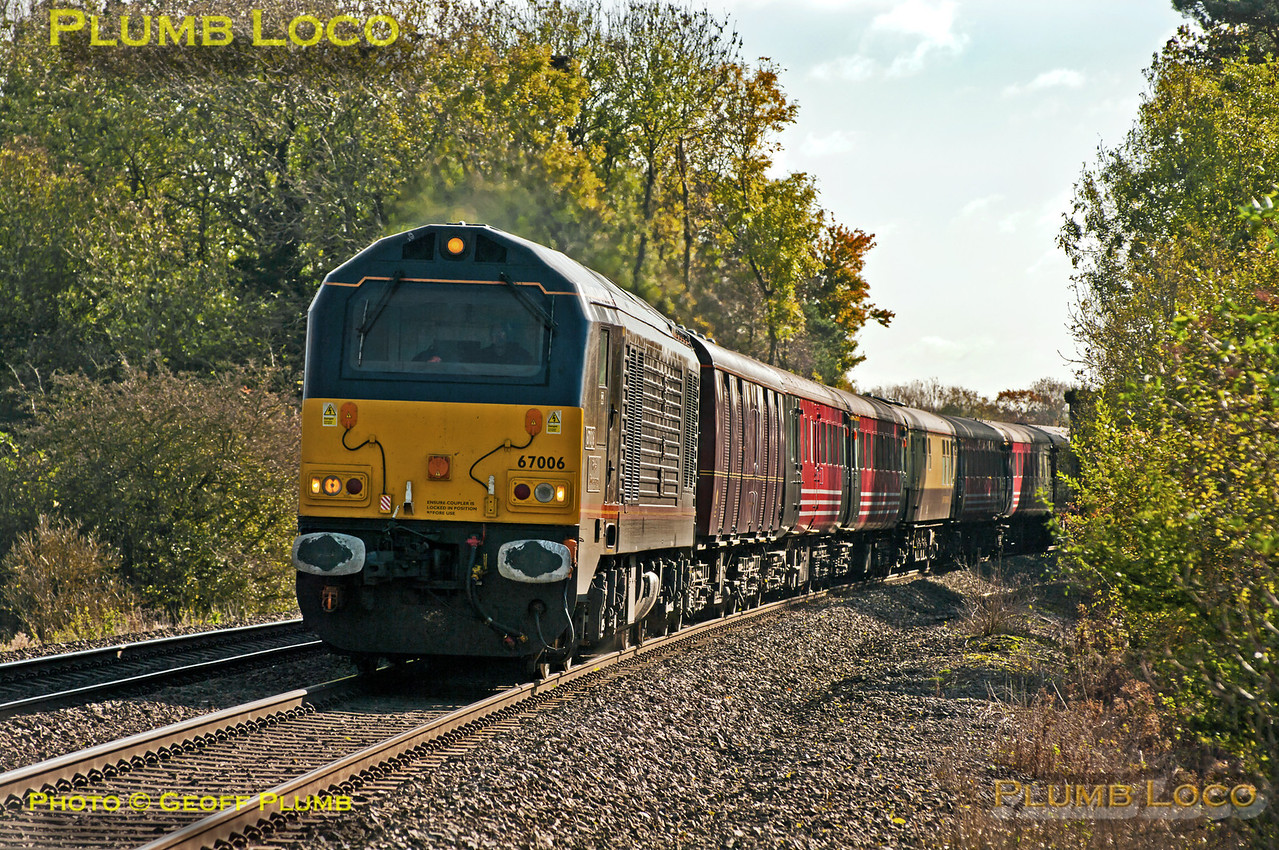 """Royal"" Class 67 No. 67006 ""Royal Sovereign"" at the head of 1Z23, the 10:05 from Southampton Western Docks to Glasgow Central boat train, at Wormleighton (just south of Fenny Compton) at 12:21 on Saturday 27th October 2012. This is usually a DRS working with Class 47s and ""The Great Briton"" set of coaches, but on this occasion was a DBS 67 and a motley set of ex-Virgin and other coaches! Digital Image No. GMPI12736. Thanks to Mark Miller for pointing out this train is actually a separate working from the DRS operated Cruisesaver and is a DBS working for Barrhead Travel..."