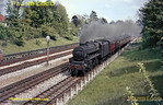 "LMS ""Black 5"" 4-6-0 No. 44715 at Pinner Green, on the four track electrified section shared with the Metropolitan line of LT, with the 14:38 semi-fast train of four coaches from London Marylebone to Nottingham Victoria, Saturday 15th May 1965. Slide No. 1313."
