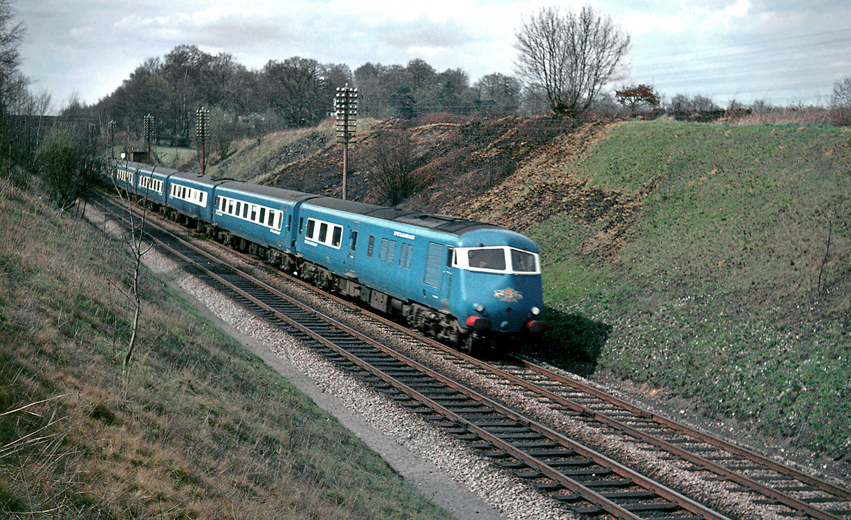 "The up working of the blue ""Birmingham Pullman"" diesel unit races towards Paddington near Seer Green in the Chilterns, Friday 9th April 1965. Slide No. 1232."