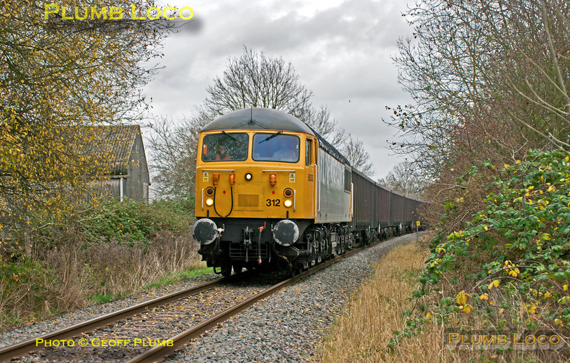 Running around 25 minutes late, 56312 is approaching Tub's Foot-Crossing, Bicester, with 6Z91, the 10:55 empty fly ash train from Calvert to Didcot Power Station, 12:17, Thursday 22nd November 2012. Digital Image No. GMPI12923.