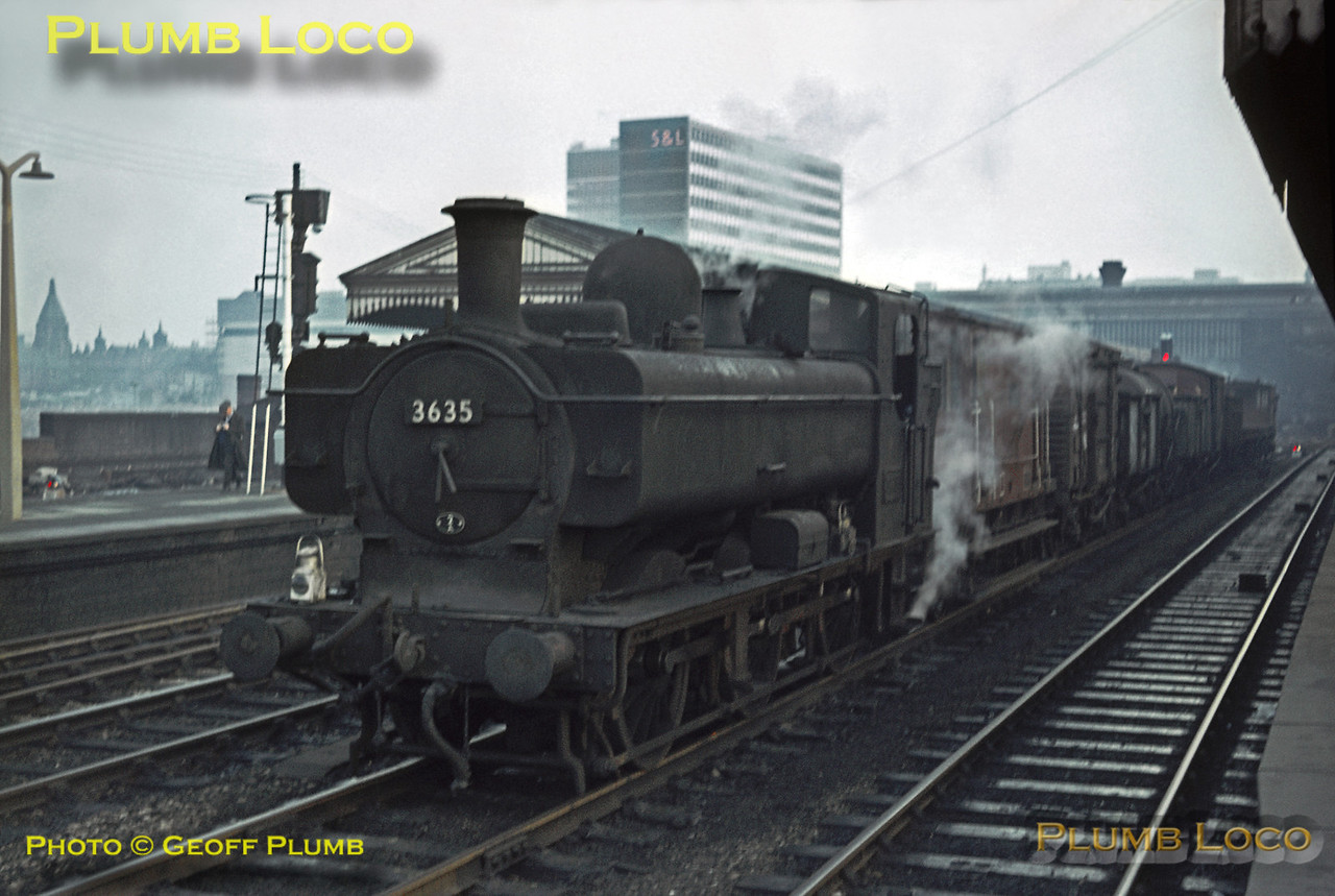 GWR 57xx class 0-6-0PT No. 3635 trundles slowly along the down through line at Birmingham Snow Hill station with a cross-city goods trip working in the last of the fading afternoon light on Saturday 21st November 1964. The loco is allocated to 2A, Tyseley MPD, by this time part of the London Midland Region of BR. Slide No. 1115.