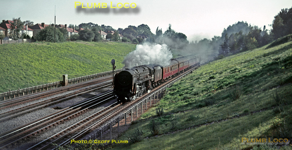 """BR Standard """"Britannia"""" 4-6-2 No. 70046 """"ANZAC"""" is rather more exotic motive power than the usual """"Black 5"""" at the head of the 14:38 semi-fast train from Marylebone to Nottingham Victoria, between Northwood and Moor Park, Saturday 9th October 1965. Slide No. 1636."""