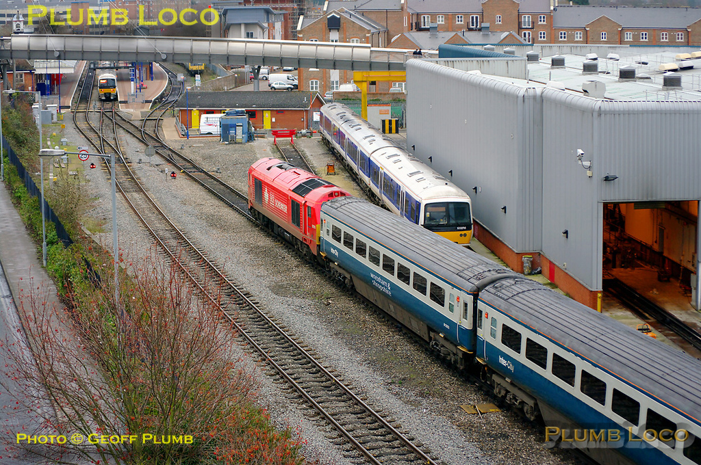 "The Chiltern LHCS service was due to start from Monday 13th December 2010 and here the stock is being marshalled at Aylesbury Depot in preparation, at 14:34 on Sunday 12th December 2010. 67018 ""Keith Heller"" is at the south end of the train with 4 Mk.3 TSOs in blue/grey livery, 2 TSOs in ex-Virgin livery and the Chiltern DVT 82302 on the rear. Shunter 01509 ""Lesley"" was also involved in the shunt but is out of sight in this view. A short while after this the train moved to the south sidings for overnight stabling. Digital Image No. GMPI7109."