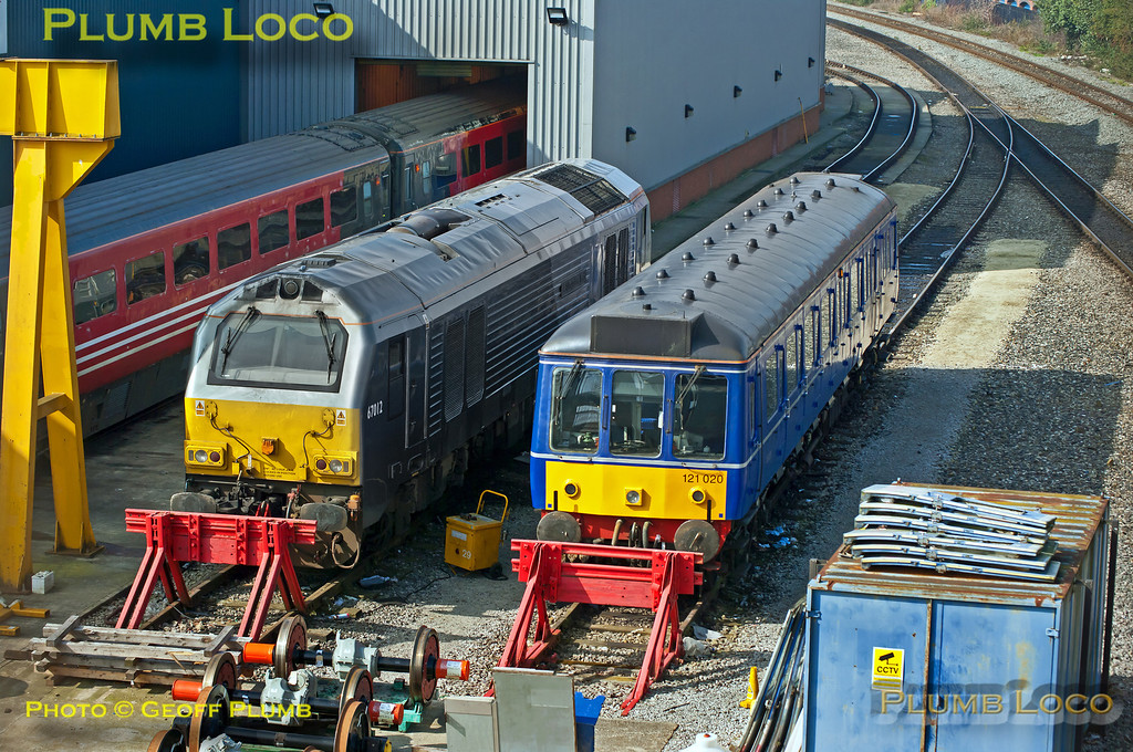 """Chiltern 67012 """"A Shropshire Lad"""" sits alongside bubblecar 121 020 in the sidings at Aylesbury DMUD, prior to returning to Wembley LMD with the three Mk. 3 coaches which had been in for attention on the wheel lathe. 12:28, Thursday 15th March 2012. Digital Image No. GMPI11250."""