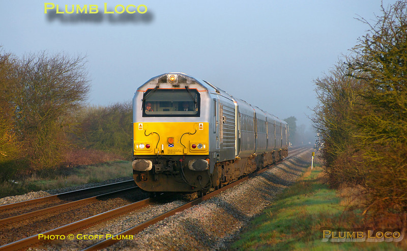"""Former W&S 67012 """"A Shropshire Lad"""" heads south at Kingsey with 1H06, the 05:46 Chiltern LHCS from Birmingham Moor Street to Marylebone service, running in beautiful early morning light. 07:03, Wednesday 23rd March 2011. Digital Image No. GMPI8240."""
