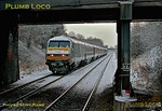 """DVT 82303 is on the rear of 1H08, the 06:53 Banbury to Marylebone train hauled by 67015 """"David J. Lloyd"""" as it departs from the stop at Haddenham & Thame Parkway just a few minutes late at 07:22 on the snowy morning of Friday 10th February 2012. Digital Image No. GMPI10966."""
