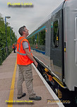 Onboard staff operate the power doors on the test train during the short stop at Denham Golf Club station as 5R00 heads north from Wembley LMD to Birmingham Moor Street as part of the bedding-in process of the newly refurbished set of Mk.3 coaches. Assuming all goes well, the stock should be introduced into normal service from 28th May 2012. 11:33, Thursday 17th May 2012. Digital Image No. GMPI11769.