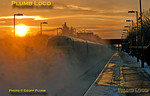 """The sun comes up in a blaze of glory over Haddenham & Thame Parkway station as 67018 """"Keith Heller"""" speeds southwards in a cloud of thrown up snow at the head of 1F91 with DVT 82304 on the rear. This is the 06:55 from Birmingham Moor Street to Marylebone express passing through at 07:54 on Friday 10th February 2012. Digital Image No. GMPI10984."""