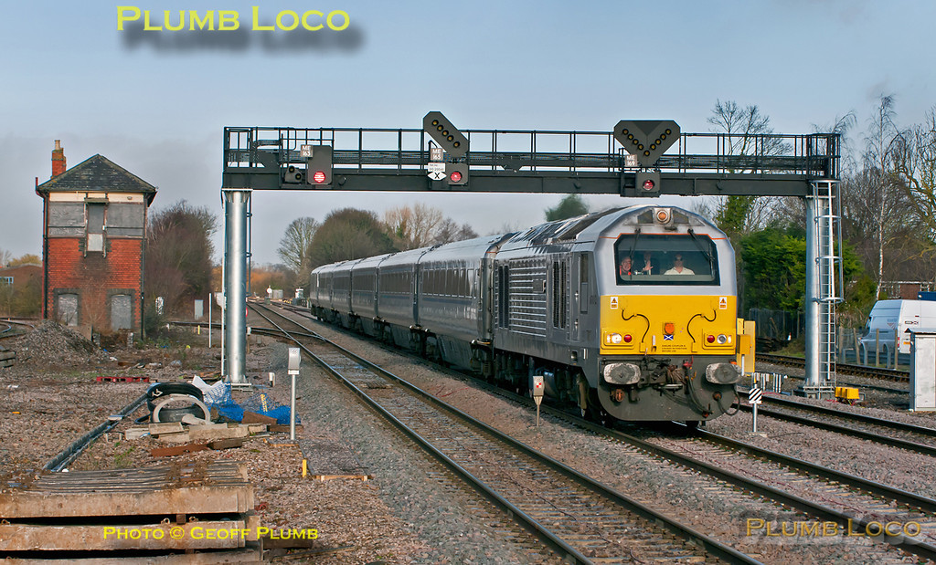 """67012 """"A Shropshire Lad"""" is hauling 1H32, the 10:55 from Birmingham Moor Street to Marylebone Chiltern Mainline Silver service, as it races south through Princes Risborough on the fast line. 12:03, Thursday 22nd December 2011. The loco seems to have collected a pheasant at some stage of the journey... Digital Image No. GMPI10686-2"""