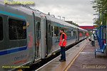 Test train 5R00, 10:59 from Wembley LMD to Birmingham Moor Street, had stopped at Haddenham & Thame Parkway as part of the testing/training on the first set of coaching stock fitted with power doors. On board staff test the doors on TSOs 12605 and 12604 during the stop at 12:21 on Monday 14th May 2012.
