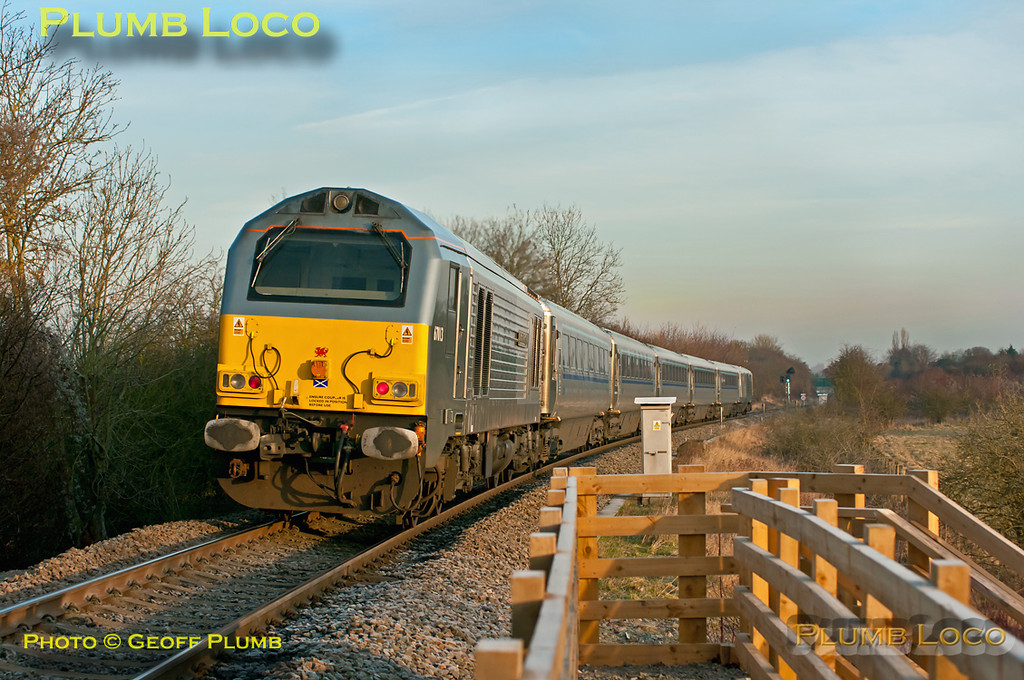 """Another frosty morning, but at last some sunshine as well! 82304 leads 1R14, the 08:37 from Marylebone to Birmingham Moor Street, with 67013 """"Dyfrbont Pontcysyllte"""" bringing up the rear of the Chiltern Mainline Silver train. It is passing the foot-crossing south of Princes Risborough on the descent from Saunderton summit, where the up and down lines are grade separated. 09:05, Tuesday 17th January 2012. Digital Image No. GMPI10827."""