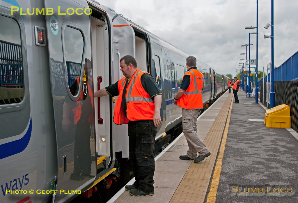 The up test train, 5H02, has stopped at Haddenham & Thame Parkway station and onboard staff open and close the power doors a few times as part of the tests. 15:48, Monday 14th May 2012. Digital Image No. GMPI11711.