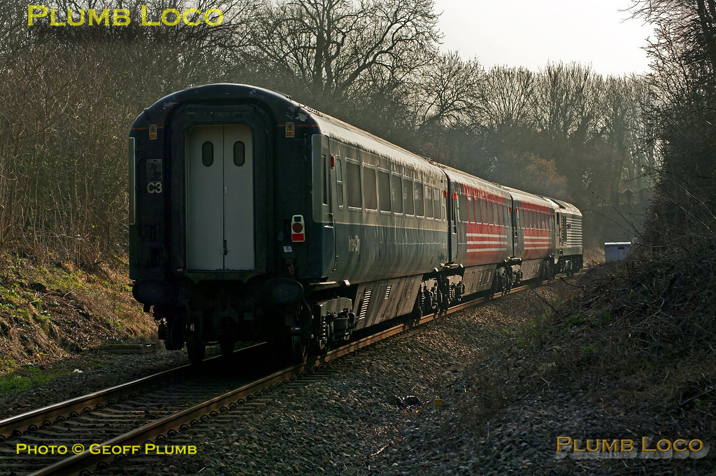 """67012 """"A Shropshire Lad"""" has just passed Little Kimble station with 5Z67, the 14:58 ECS working from Aylesbury DMUD to Wembley LMD via Greenford and Acton Wells. The three coaches, numbers 12094, 12017 and 12043, had been at Aylesbury for tyre-turning on the wheel lathe. 15:08, Thursday 15th March 2012. Photo taken from a public footpath across the line. Digital Image No. GMPI11298."""