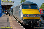 "On Monday 8th August 2011, 1H08, the 06:53 from Banbury to Marylebone, was unusually formed of one of the Chiltern silver sets rather than the normal ""Hybrid"" set, due to various untoward events the previous Friday. Passengers board at Princes Risborough and the train departed on time at 07:30, unfortunately failing at Saunderton due to a loss of coolant via a faulty heat exchanger, causing the loco to shut down. Fortuitously, the train was able to coast downhill to High Wycombe where passengers could be detrained and other trains get round the casualty, albeit with consequent delays. Digital Image No. GMPI9981."
