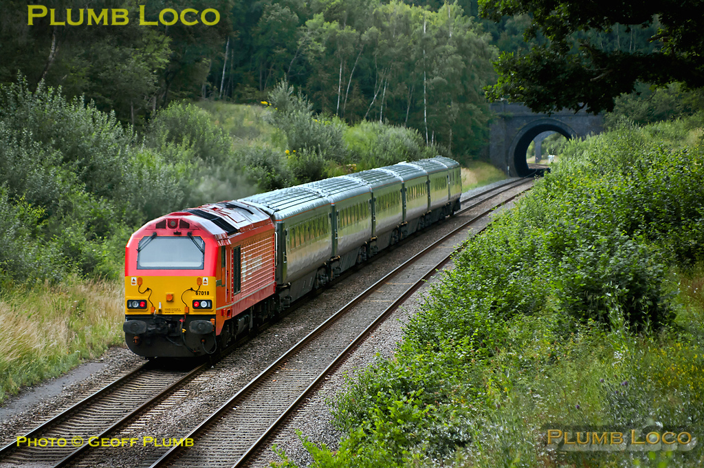 """67018 """"Keith Heller"""" was back in action for Chiltern Railways from 13th July 2011, working 1R47, the 16:30 from Marylebone to Birmingham Moor Street with set AL03, one of the former WSMR sets. It is seen approaching Brill Tunnel at 17:18 on Wednesday 13th July 2011. Digital Image No. GMPI9721."""