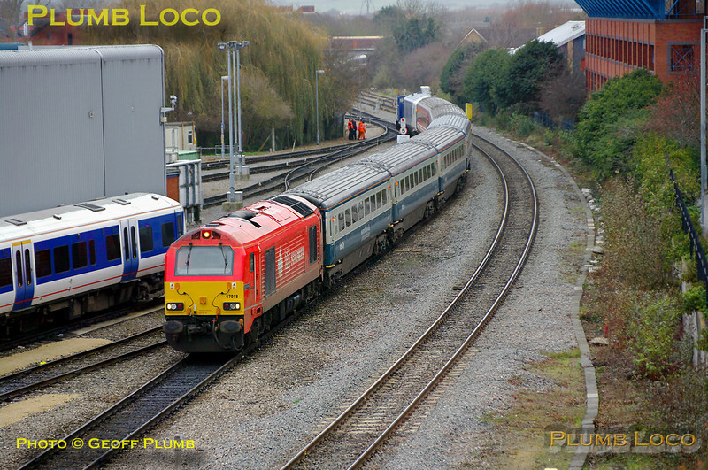 """The Chiltern LHCS service was due to start from Monday 13th December 2010 and here the stock is being marshalled at Aylesbury Depot in preparation, at 14:25 on Sunday 12th December 2010. 67018 """"Keith Heller"""" is at the south end of the train with 4 Mk.3 TSOs in blue/grey livery, 2 TSOs in ex-Virgin livery and the Chiltern DVT 82302 on the rear. Shunter 01509 """"Lesley"""" was involved in the shunt and can be seen beyond the DVT. A short while after this the train moved to the south sidings for overnight stabling. Digital Image No. GMPI7100."""