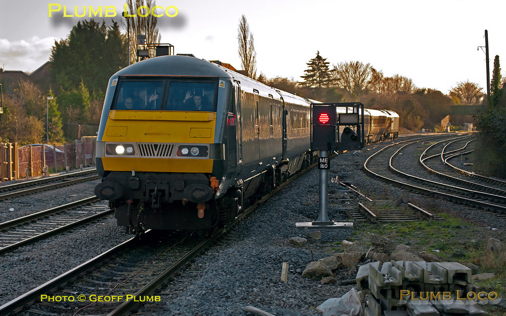 """67013 """"Dyfrbont Pontcysyllte"""" is propelling the train with DVT 82303 leading as 1R34, the 13:37 from Marylebone to Birmingham Moor Street Chiltern Mainline Silver service, approaches Princes Risborough station at 14:07 on Thursday 22nd December 2011. Digital Image No. GMPI10711."""