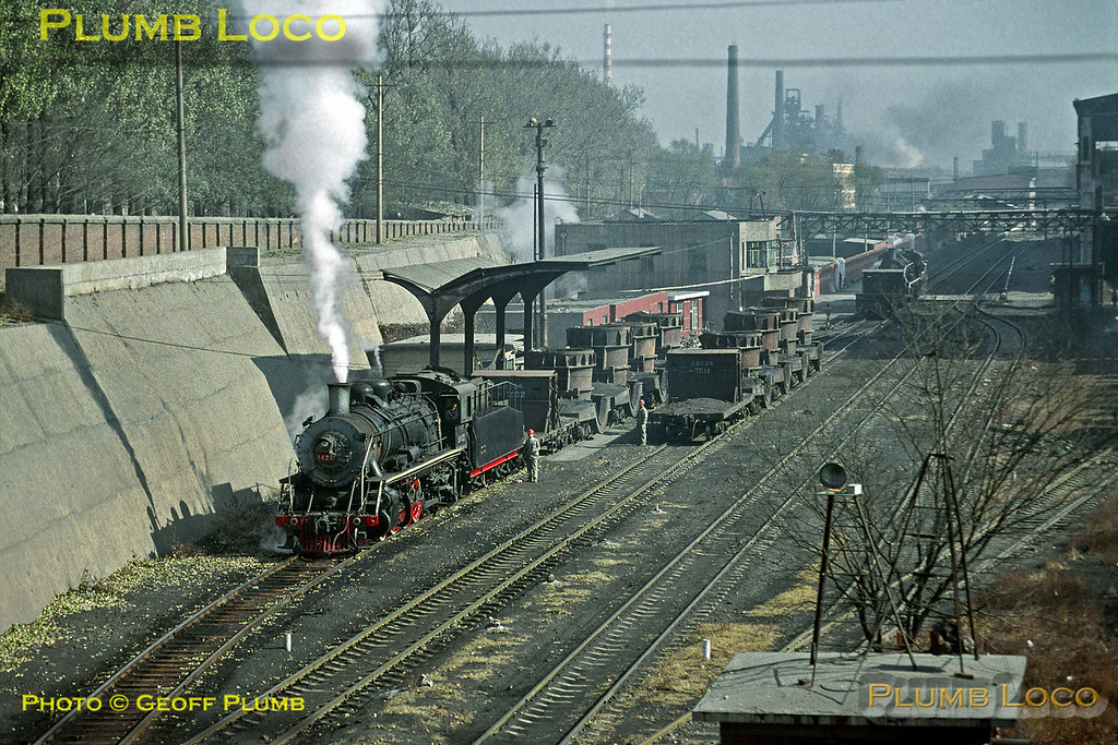 SY1422 is shunting some cauldron wagons loaded with molten steel around the steelworks at the end of the branch from Chengde at around mid-day on Monday 4th November 2002. Slide No. 30425.