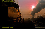 Sunrise at Daqing loco depot on the Tiefa coal-mining system. On the left SY1771 glints in the early sunshine as a fellow SY 2-8-2 goes off depot in the distance. The level-crossing had been closed for this move - it has now reopened to allow coal-miners on their bikes to head for the nearby pithead, 06:45, Wednesday 6th November 2002. Slide No. 30747.