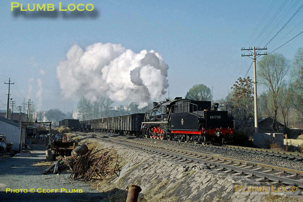 SY class 2-8-2 No. SY1726 returns from the steel works at Chengde with a train of empty coal wagons, approaching the yards at Shuangtashan. 09:15, Monday 4th November 2002. Slide No. 30364.
