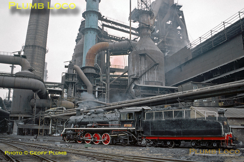 SY Class 2-8-2 No. SY0835 is nicely bulled-up in the industrial environment of the huge steelworks at Anshan, dwarfed by the blast furnaces towering over it, Tuesday 5th November 2002. Slide No. 30574.