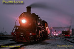 Dusk at Daqing loco depot on the Tiefa coal-mining system, and there is now a light covering of snow on the ground as SY1769 is prepared for its next duty. In the background, the steam crane used to coal the engines trundles along its siding. 16:45, Thursday 7th November 2002. Slide No. 31094.