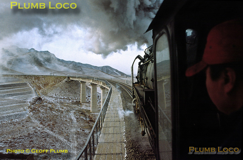 """Driver's eye view from QJ6274 as it blasts its way across Simingyi """"Horseshoe"""" Viaduct on the eastbound climb of the Jing Peng Pass, double-heading with QJ7143 on train 44143, the 06:15 from Haloukou to Daban, about 08:20, Monday 11th November 2002. Slide No. 31558."""