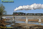 2-8-2 No. SY1726 crosses the river bridge near the steelworks on the branch from Chengde with another loaded coal train, its exhaust steam condensing nicely in the cold air. 10:10, Monday 4th November 2002. Slide No. 30385.