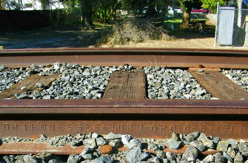 I don't know the whole code, but enough to know that this rail was rolled out at a mill in Tennessee in the year 1919.  There's newer rail on this line - which goes all the way to Ventura - but probably not too much older (the far rails says 1913), though rails were first laid in the area in 1887.