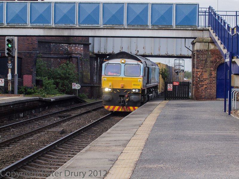 Class 66, 66 434, hauling a container train northbound and passing through platform 2.