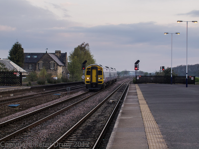 Trans Pennine 158 758 on a Blackpool train, passing the station on the through line from York.