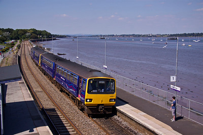 143611 & 143620 slow to a stop at Starcross Station with 2T20 14:23 Exmouth - Paignton service on 24/07/12.