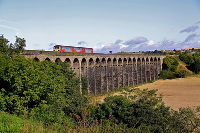 144016 crosses the majestic Penistone Viaduct with the 08:36 Sheffield - Huddersfield service on 22/08/09.