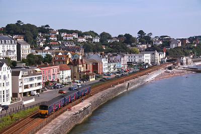 150921 renumbered 3-Car hybrid passes the sea wall at Dawlish with 2C67 08:00 Cardiff Central - Paignton, 26/07/12.