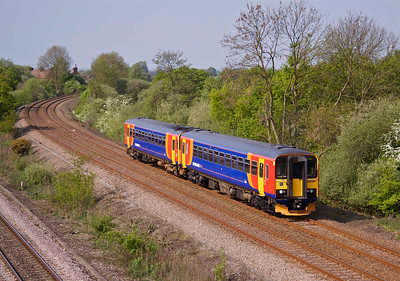 153385 & 153383 approach North Stafford Junction with a train to Derby, 30/04/11.