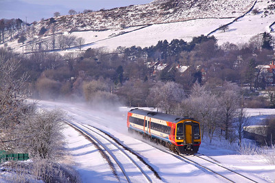 158770 whips up the snow passing Chinley North with the 09:52 Liverpool Lime Street - Norwich, 03/12/10.