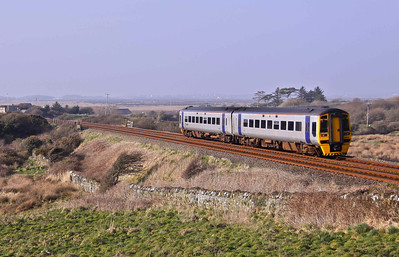 158819 passes Rhosneigr on Angelsey with 1G60 15:23 Holyhead - Birmingham International on 26/03/11.