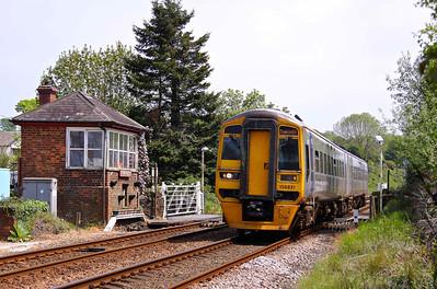 158831 passes the signal box of Llanfair P.G. with 1D12 09:09 Birmingham International - Holyhead service, 22/05/10.