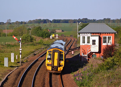 158721 heads North past Inverkeillor signal box and its semaphore signals with 1A43 06:01 Perth - Inverurie on 31/05/11.