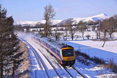 170306 & 170303 scurry through the scenic, snow covered Hope Valley at Thornhill, with 1B76 12:18 Manchester Piccadilly - Doncaster service on Sunday 03/01/10.
