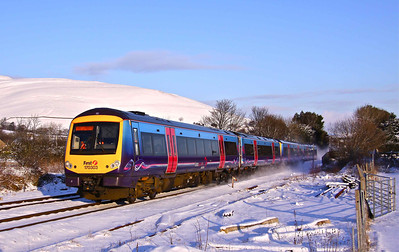 170303 & 170306 whip up the snow as they pass through Edale Station with 1B79 13:43 Doncaster - Manchester Airport, on Sunday 02/01/10.