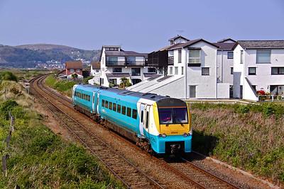 175011 runs along the Llandudno Branch at Daganwy with 2D73 16:10 Llandudno - Llandudno Junction, 22/05/10.