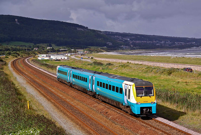 175103, hits a patch of sunlight as it approaches Abergele with 1H85 09:45 Llandudno - Manchester Piccadilly, 29/08/09.