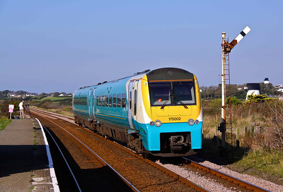175002 passes through the staggered platforms of Ty Croes Station, Angelsey, 28/09/11.