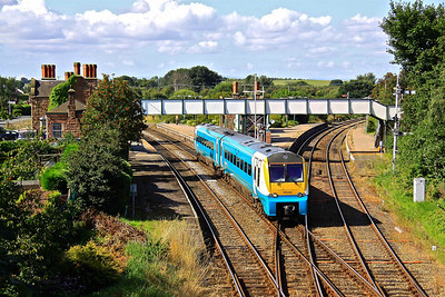 175005 pulls away from the delightful environs of Helsby, with 1H84 08:45 Llandudno - Manchester Piccadilly, 07/08/09.
