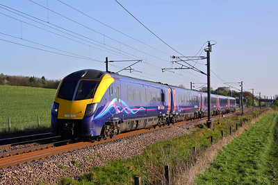 180109 in the striking First Hull Train's livery, passes Eaton Lane Crossing, South of Retford working 1H05 16:05 Kings Cross - Hull, 08/04/11.